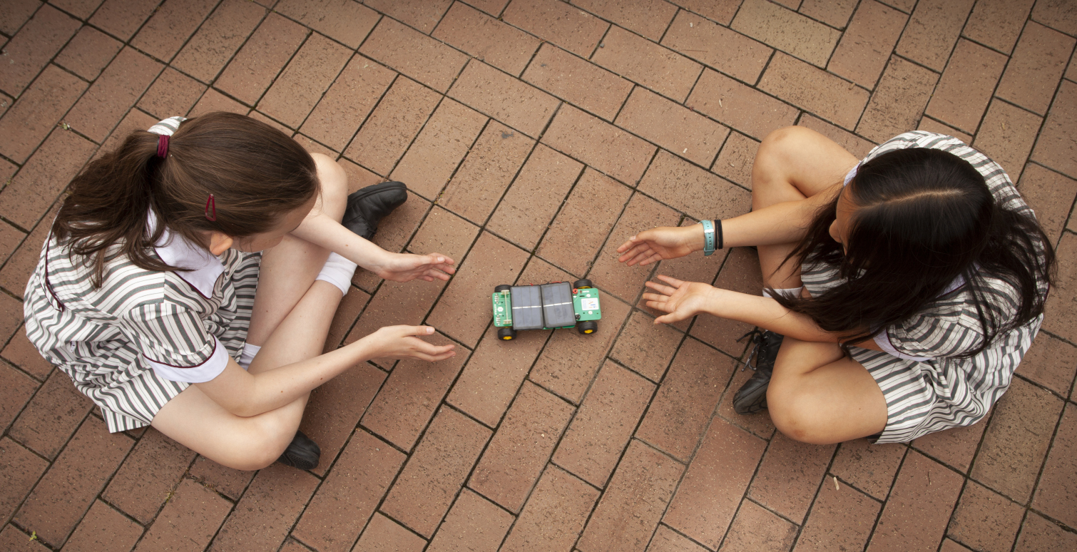 Students experiment with a solar powered car. Photo: Eamon Gallagher
