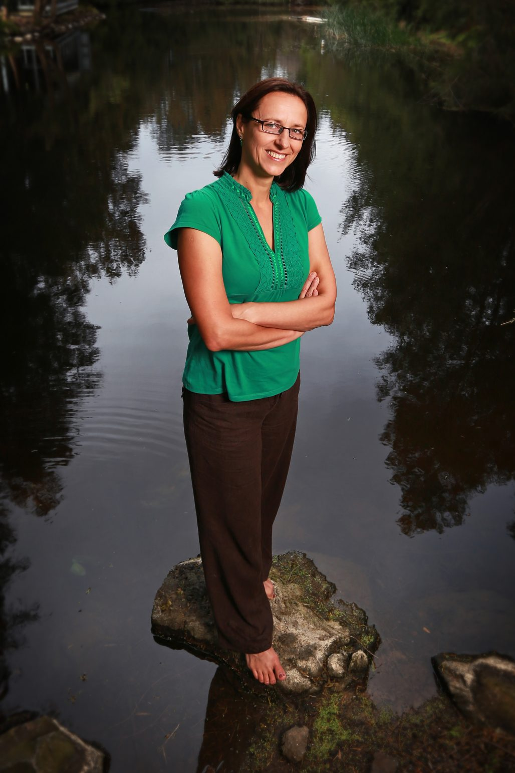 Ana Deletic standing on a rock with a body of water behind her. Photo: University of NSW