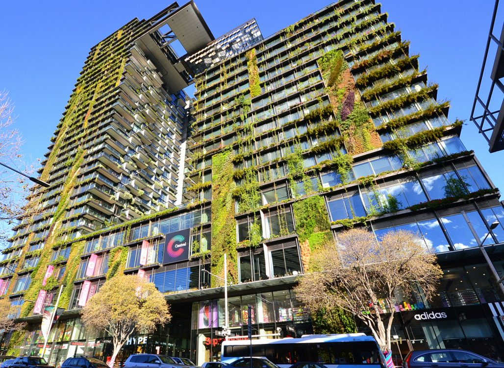 One Central Park, a tall city building covered in flourishing plants.