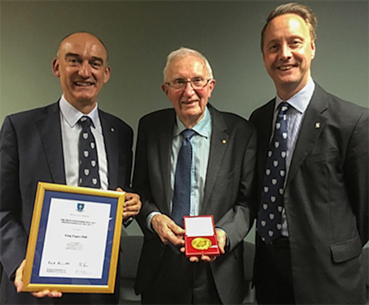 Greg Tegart receiving an award