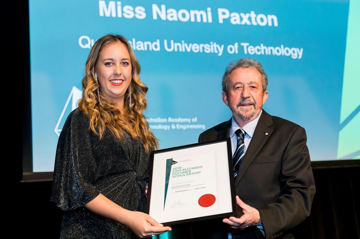 Naomi Paxton receives her award from Ezio Rizzardo