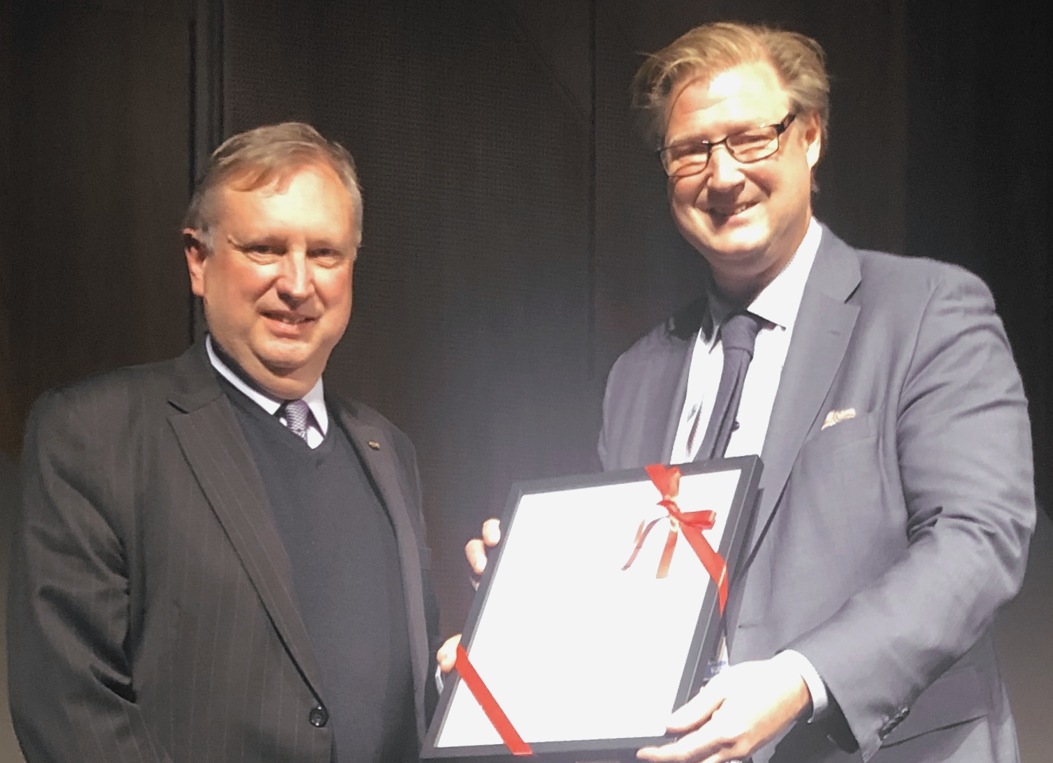 Professor Murray Scott (left) receiving his certificate from and the ICCM President, Professor Leif Asp (left).